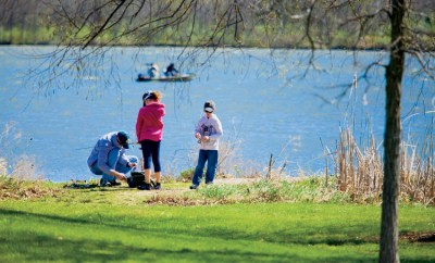 People fishing at Shabbona Lake State Park.  Shabbona Lake State Park is a popular outdoor destination in DeKalb County, located just in Shabbona.
