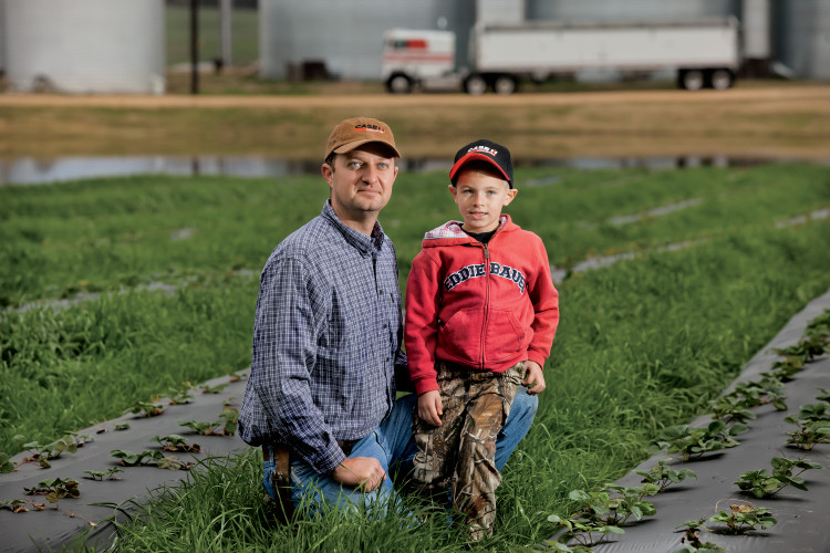 Ben Moore poses for a portrait with his 5 yr. old son Miller. Ben farms 3,500 acres in Weakley County, Tennesee.