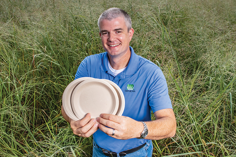 Genera's Sam Jackson holds biodegradable, compostable plates made using agricultural pulp fiber from Tennessee-grown crops such as switchgrass.